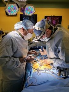 Surgeons perform a trans-umbilical (belly button) implantation of lumbar artificial disc